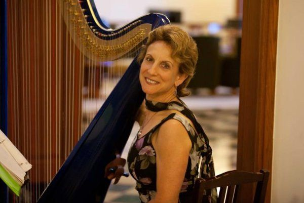 Smiling harpist