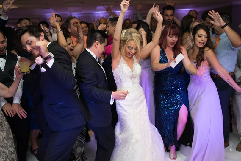 The bride and groom dancing with guests