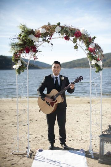 Carlos played his guitar as daisy walked down the isle. How romantic!