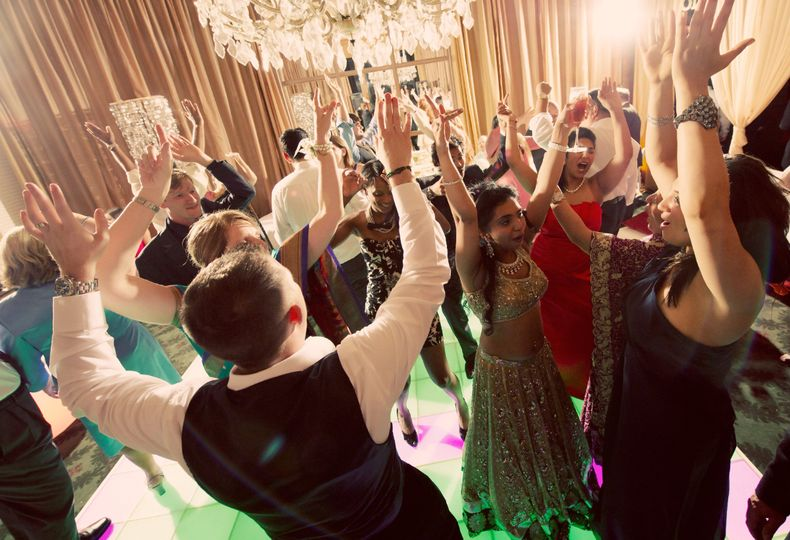 Light up your night with an interactive lit dance floor and chandeliers overhead!