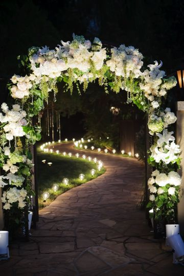 Pathway lighting and feature lighting on a floral arch
