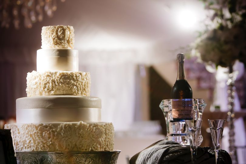 A cake spot will highlight this beautiful focal point of your wedding or special event.