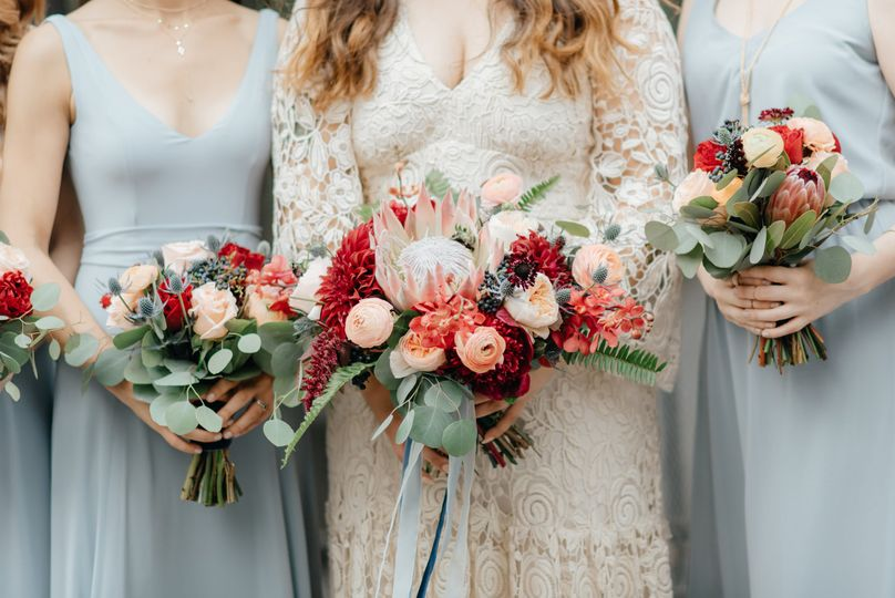 Bride and bridesmaids with spring flowers