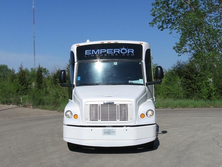 This is what our party buses look on the outside. Great lines, clean, chrome wheel simulators, pearl...