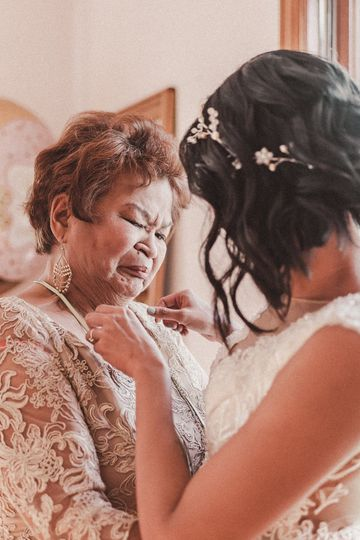 Mom crying with bride