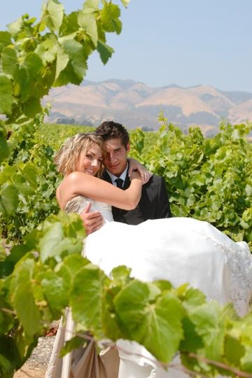 Edna Valley Vineyard groom carries bride