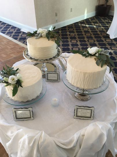 Three white wedding cakes