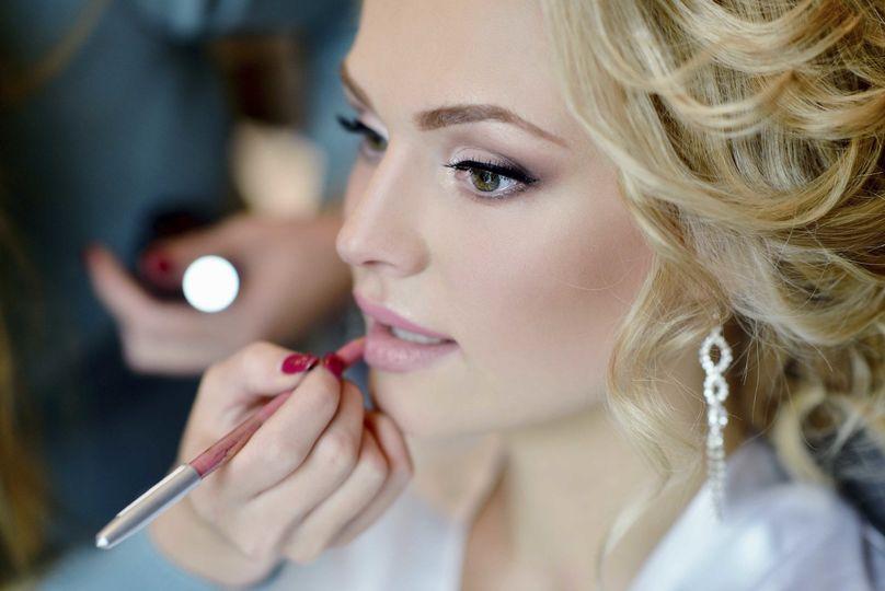 blond woman gets makeup done horizontal big