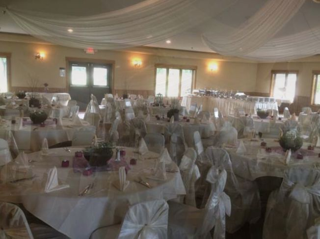 Wedding reception area with white table set-up
