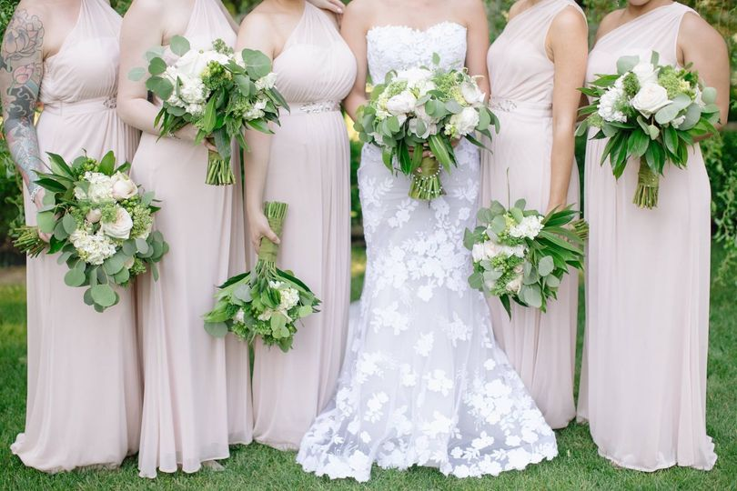 The bride with bridesmaids' bouquets