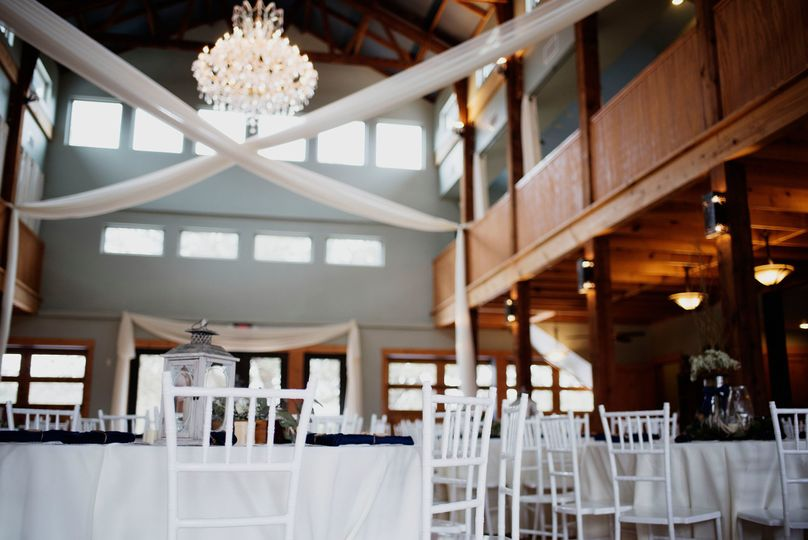 White Linens & Chiavari Chairs Are Included with Every Venue Rental. Interior of the Grand Reception...