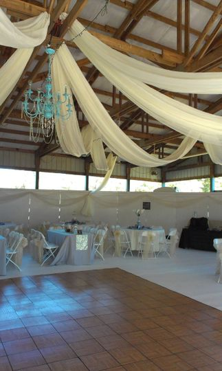 blue chandelier and ivory drape