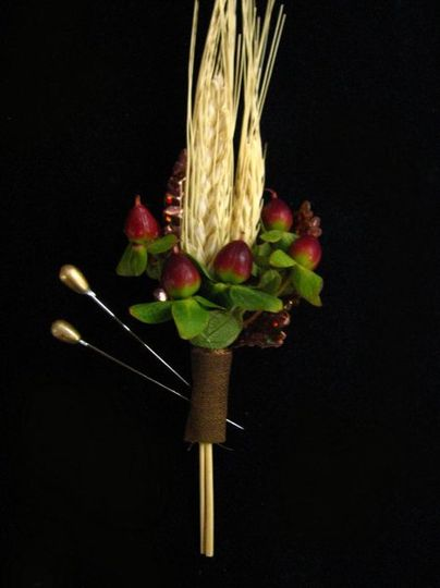 Wheat and red Hypericum boutonniere