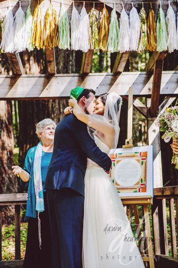 Masha and kellen's big kiss at a fun wedding september 2014 in chenoweth woods