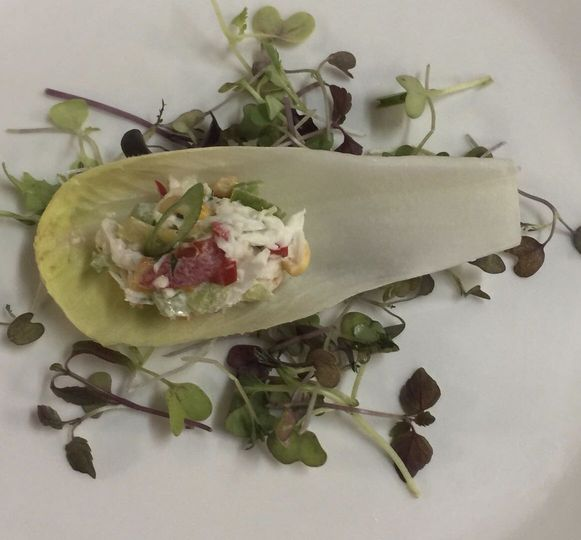Old bay crab salad on endive boat