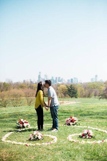 Newly engaged couple kissing
