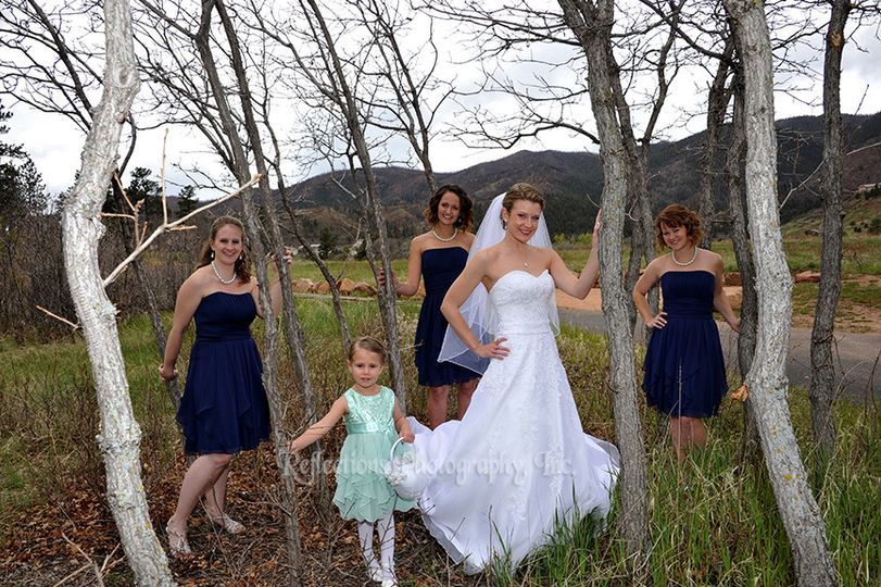 The bride with her bridesmaids and flower firl
