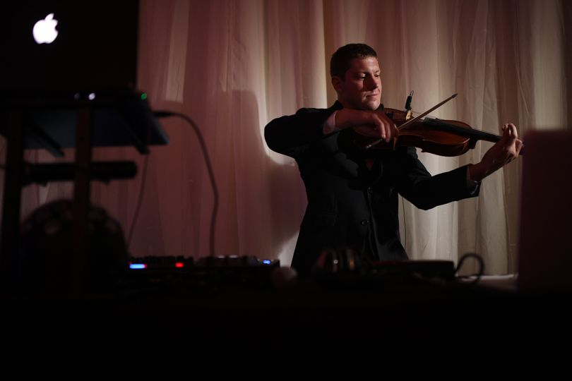 Playing the violin at the DJ booth
