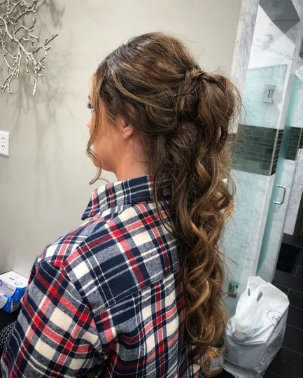 Long curls in a ponytail