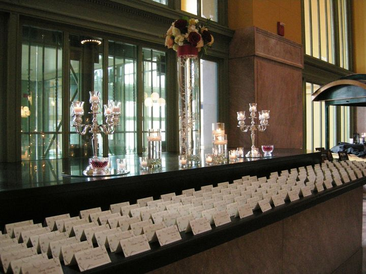 Place Card display with Candelabras, Cylinders with Floating Candles and Tall Cylinder with...