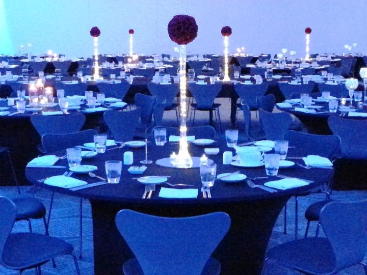Eiffel Vases with Red Rose Pomander Balls at top with LED Rice Lights submerged in vase. At Radisson...