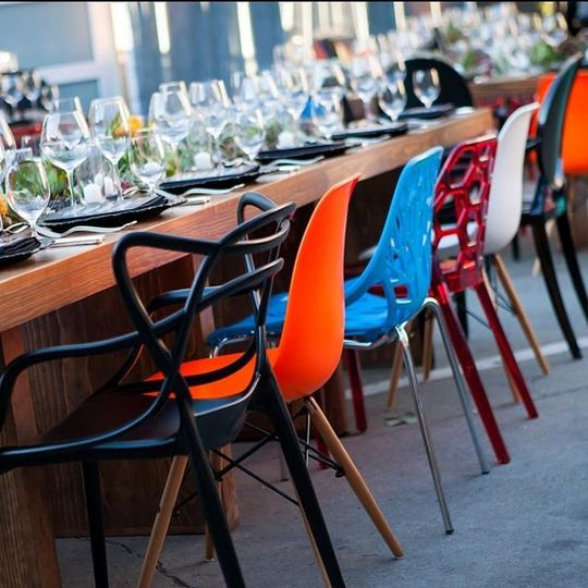A beautiful collection of eclectic chairs says this celebration is fun, festive, and thinking...