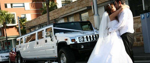 Newlyweds by the stretch Hummer