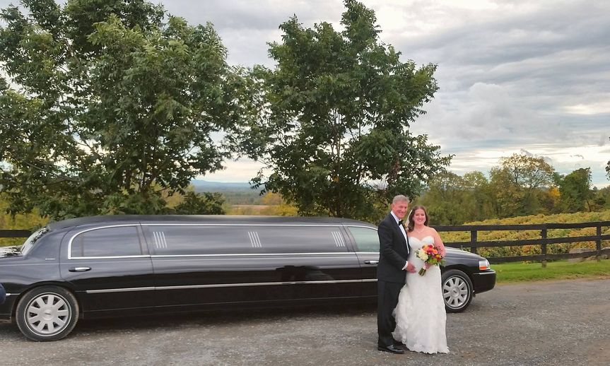 Newlyweds by the limo