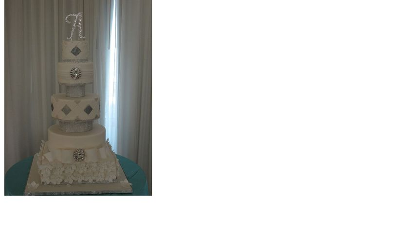 5 tier white and platinum floating wedding cake with floral base