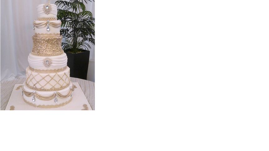 White wedding cake with gold details