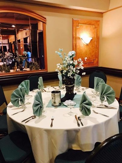 Round table setup with green decor