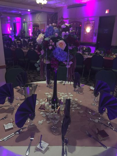 Raised floral centerpiece and table decor