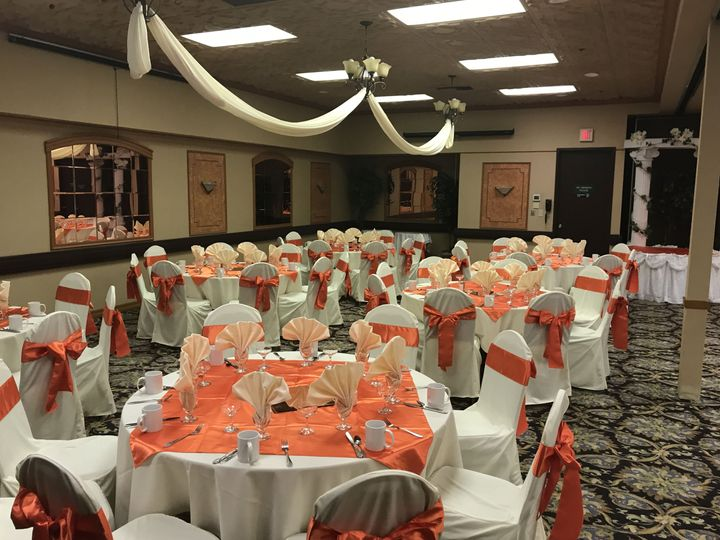 Reception tables and peach decor