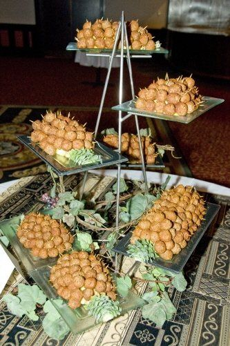 Caribbean spiced meatballs with pineapple. Served with Assorted Sauces.