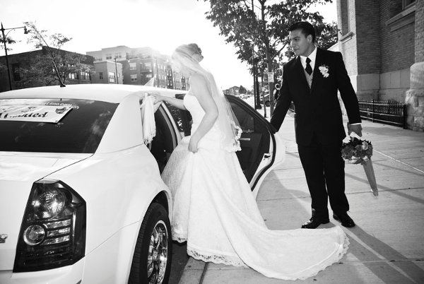 Bride & Groom entering our Chrysler 300 Limo after the ceremony