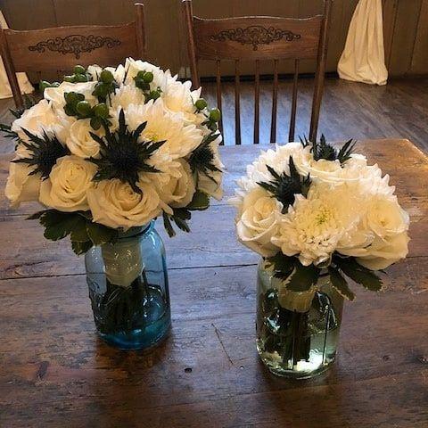 White flowers in vases