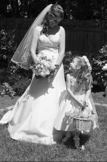 Bride with Flower Girl in mom's back yard before the wedding