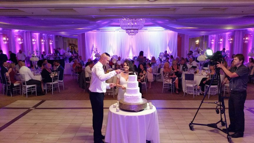 Couple with their wedding cake