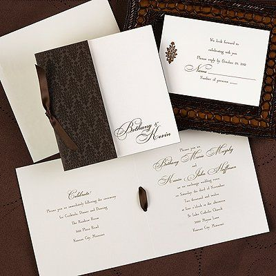 Intricate MochaAn intricate mocha wrap with a mocha ribbon ties in the details for your wedding day!