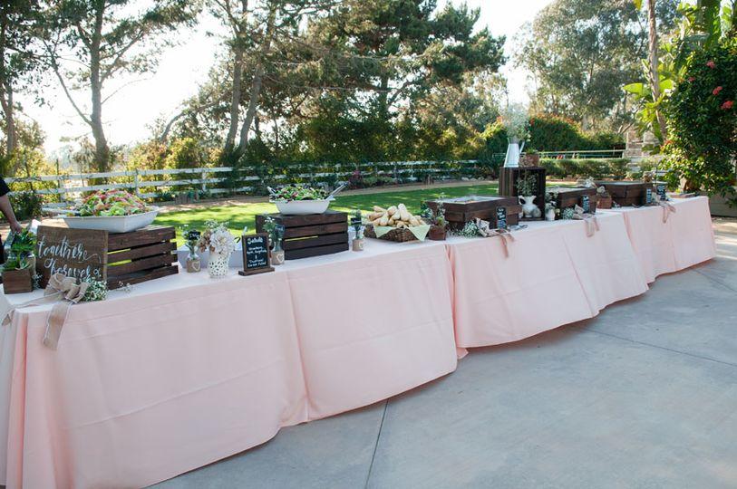 A buffet with peach linens