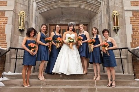 Bride and bridesmaids by the steps