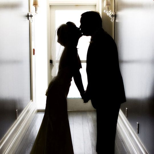 bride groom kissing silhouette