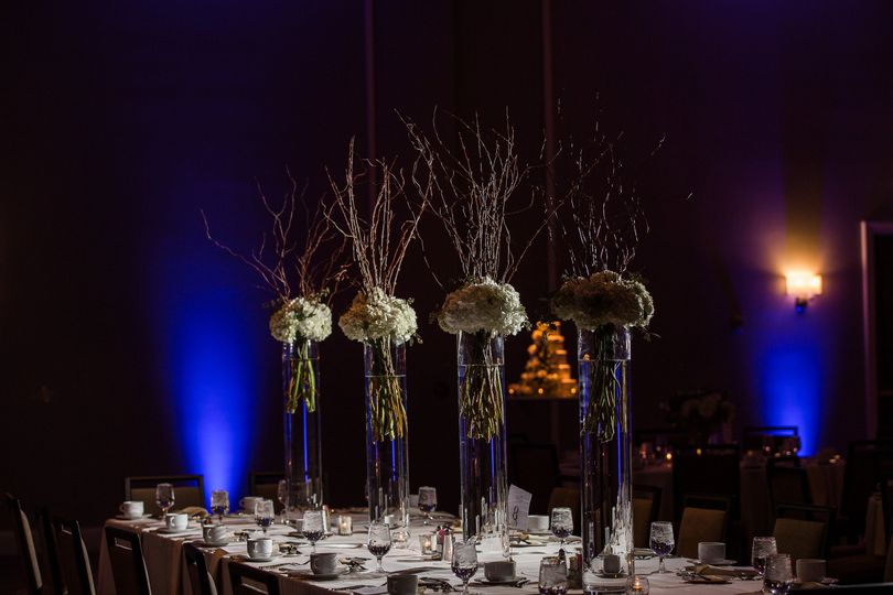 Table floral centerpiece with blue lighting