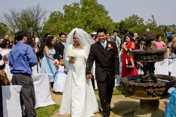 Mona & Kim - passing by the ceremony area fountain after exchanging marriage vows.