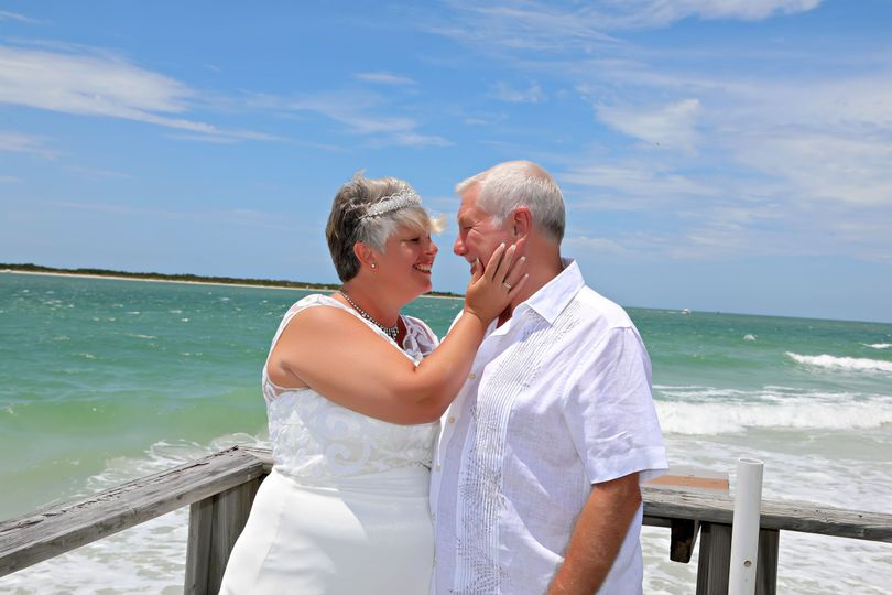 Newlyweds with the beach in the background