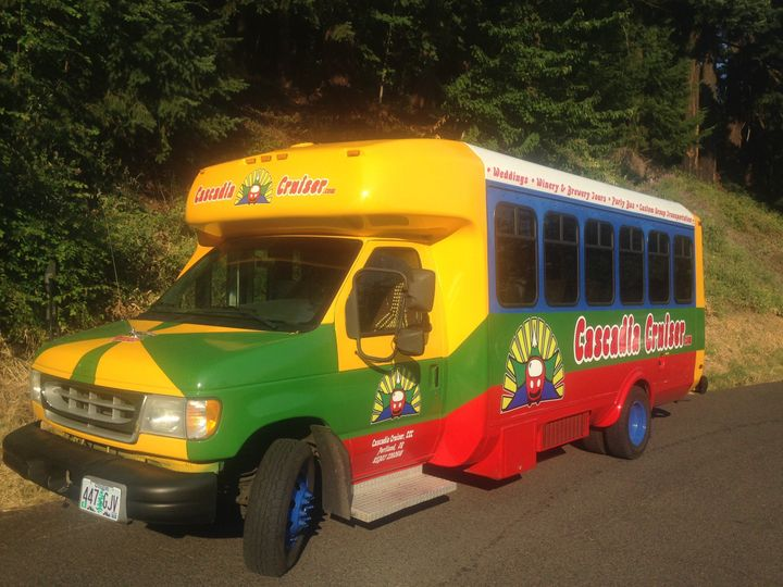 "Our beautiful ""Pegasus"" Bus out and about in a park. She can seat 15-18. Pegasus has 13..."