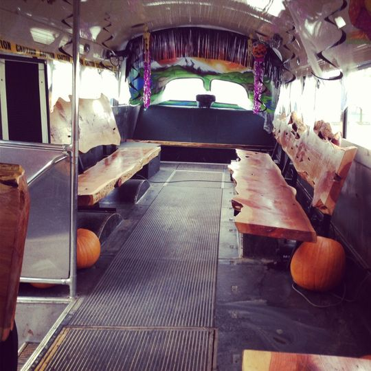 "An interior shot of our mighty ""Sasquatch"" bus! She seats 35+ of beautiful handmade wood benches of..."
