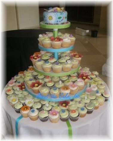 Gumpaste wildflowers rest atop each deliciously moist cupcake on this fresh cupcake tower.