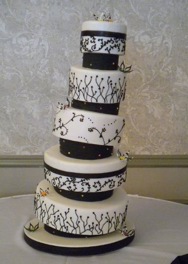 Black and white crooked cake.  Structurally sound so it only looks like it's falling over!
