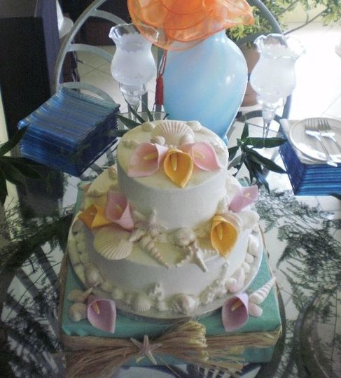 2-tier round cakes finished in white buttercream.  Hand made edible fondant calla lillies and...